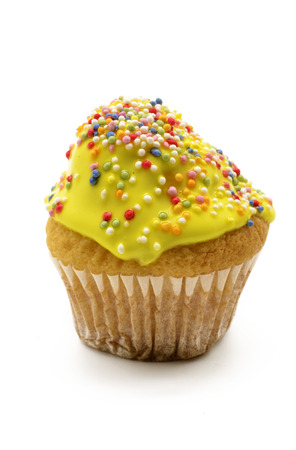 cupcakes isolated: cupcake with yellow cream
