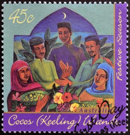 cocos: COCOS (KEELING) ISLANDS - CIRCA 1996: A stamp printed in Cocos (Keeling) Islands shows members of Malay community, circa 1996