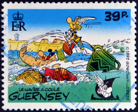asterix: GUERNSEY - CIRCA 1992 : stamp printed in Guernsey shows the ship sinks, belonging to the comic Asterix and Obelix, circa 1992