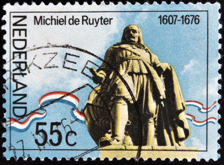 holand: NETHERLANDS - CIRCA 1976: A stamp printed in Holand shows statue of Admiral Michiel Adrianszoon De Ruyter over the sea in Flushing, circa 1976