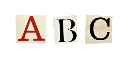 ABC letters formed with magazine letters on a white background photo