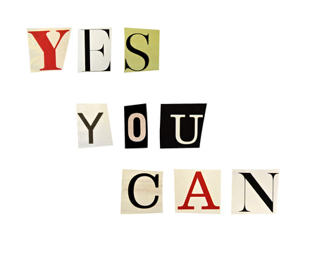 The phrase Yes You Can formed with magazine letters on white background photo