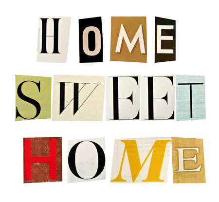 The phrase Home Sweet Home formed with magazine letters on white background photo