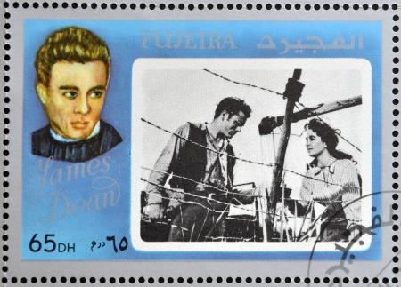 dean: FUJEIRA - CIRCA 1972 : stamp printed in Fujeira shows actor James Dean, circa 1972  Editorial