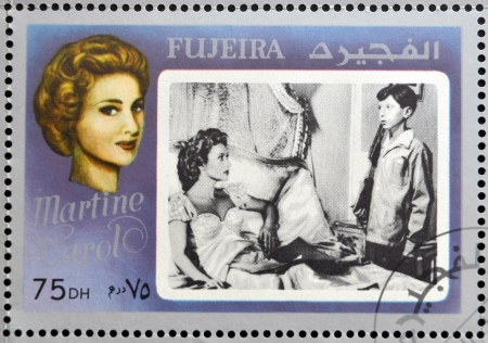 FUJEIRA - CIRCA 1972 : stamp printed in Fujeira shows french actress Martine Carol, circa 1972