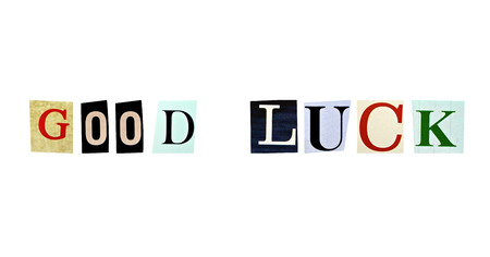 The phrase Good Luck formed with magazine letters on white background photo