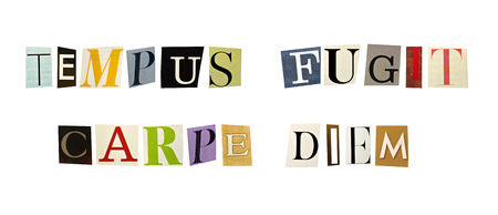 The phrase Tempus Fugit, Carpe Diem formed with magazine letters on white background photo