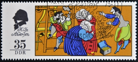 narrator: GERMANY - CIRCA 1975: A stamp printed in Germany shows The Emperors New Clothes, scene from a fairy tale by Hans Christian Anderse, circa 1975  Editorial