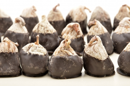dried figs with almonds topped with chocolate photo
