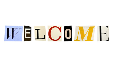 The word welcome formed with magazine letters on white background photo
