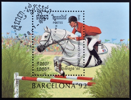 equitation: CAMBODIA - CIRCA 1992: A stamp printed in Cambodia dedicated to summer olympic games Barcelona 1992 shows equitation, circa 1992