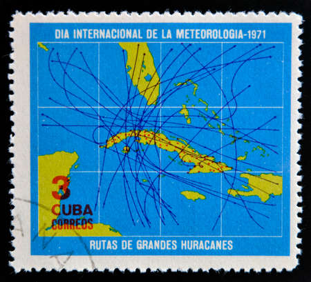 CUBA - CIRCA 1971: A stamp printed in Cuba dedicated to International Day of meteorology, shows map of Cuba with the path of great hurricanes, circa 1971  photo