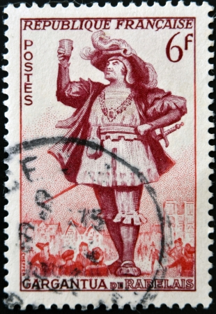 humanistic: FRANCE - CIRCA 1953: a stamp printed in France shows image of Gargantua, the literary character created by Francois Rabelais, circa 1953