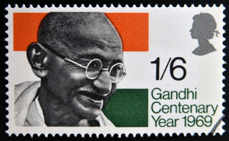 nonviolent: UNITED KINGDOM - CIRCA 1969: a stamp printed in Great Britain shows Mahatma Gandhi and flag of India, circa 1969