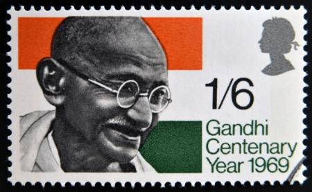 mahatma: UNITED KINGDOM - CIRCA 1969: a stamp printed in Great Britain shows Mahatma Gandhi and flag of India, circa 1969