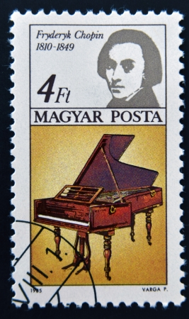 repertoire: HUNGARY - CIRCA 1985: A stamp printed in Hungary shows image of the famous composer Frederic Chopin and piano, circa 1985 Editorial