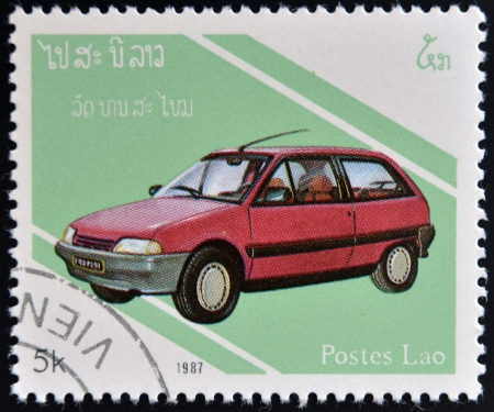 renault 5: LAOS- CIRCA 1987: A stamp printed in Laos dedicated to cars shows Renault 5, circa 1987