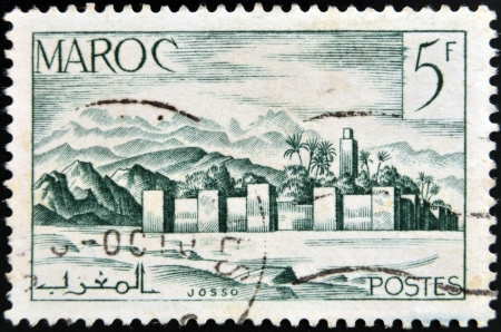 MOROCCO - CIRCA 1949: A stamp printed in Morocco shows fortified city, circa 1949