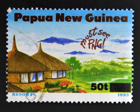 PAPUA NEW GUINEA - CIRCA 1995: A stamp printed in Papua dedicated to tourism shows resorts, circa 1995 Stock Photo
