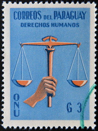 united nations: PARAGUAY - CIRCA 1960: A stamp printed in Paraguay dedicated to protection of human rights by the United Nations, circa 1960