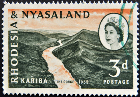 RHODESIA AND NYASALAND - CIRCA 1955: A stamp printed in Rhodesia  shows Kariba, the gorge and Queen Elizabeth II, circa 1955