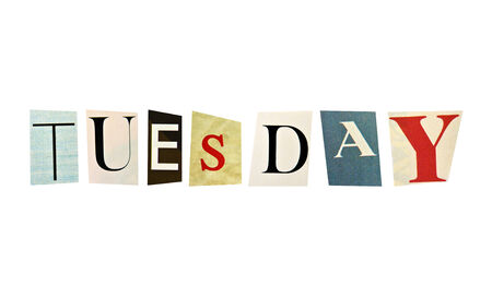 Tuesday formed with magazine letters on a white background