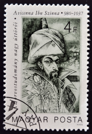 ibn: HUNGARY - CIRCA 1987: A stamp printed in Hungary shows portrait of Avicenna Ibn Sina (Kanun book of medical rules), circa 1987