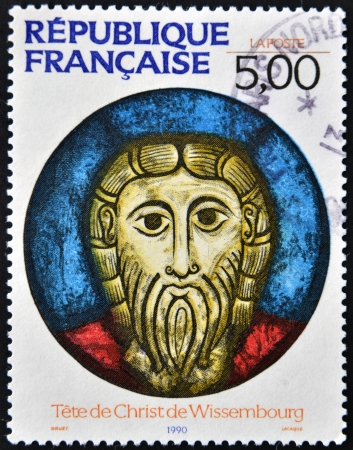 FRANCE - CIRCA 1990: A stamp printed in France shows The head of Christ, Wissembourg, circa 1990 Editorial