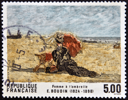 FRANCE - CIRCA 1987: A stamp printed in France shows Woman with umbrella by Boudin, circa 1987