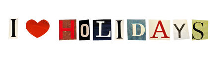 I Love Holidays formed with magazine letters on a white background photo