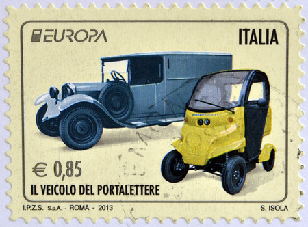 mailmen: ITALY - CIRCA 2013: Stamp printed in Italy shows an old post car and a contemporary hybrid driven vehicle, circa 2013 Editorial