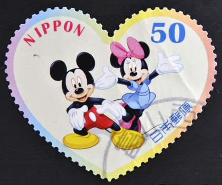JAPAN - CIRCA 2012: A stamp printed in Japan shows Mickey Mouse and Minnie Mouse, circa 2012