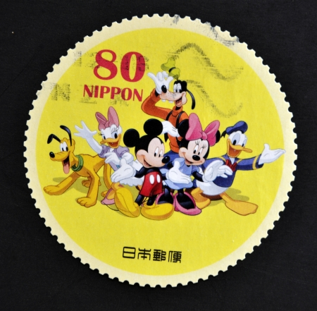 JAPAN - CIRCA 2012: A stamp printed in Japan shows Mickey Mouse, Minnie Mouse, Donald Duck, Daisy Duck, Goofy and Pluto, circa 2012