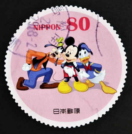 donald: JAPAN - CIRCA 2012: A stamp printed in Japan shows Mickey Mouse, Donald Duck and Goofy, circa 2012  Editorial