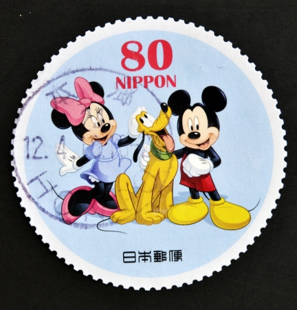 minnie mouse: JAPAN - CIRCA 2012: A stamp printed in Japan shows Mickey Mouse, Minnie Mouse and Pluto, circa 2012  Editorial