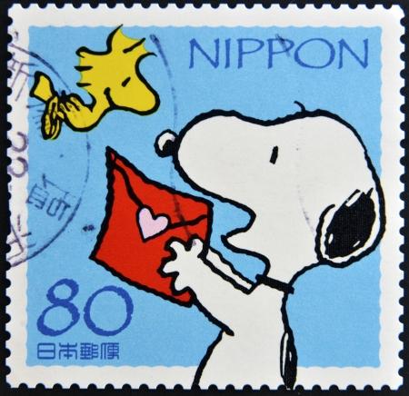 JAPAN - CIRCA 2000: A stamp printed in Japan shows Snoopy, circa 2000  Editorial