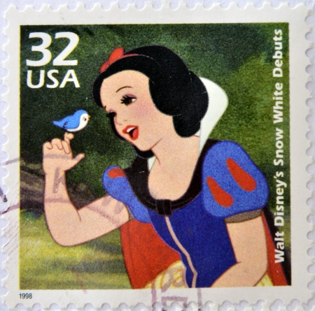 seven dwarfs: UNITED STATES OF AMERICA - CIRCA 1998: A stamp printed in USA commemorative of the Snow White movie debut, circa 1998.  Editorial