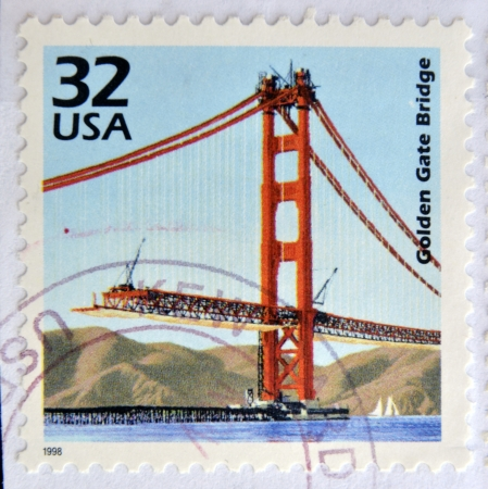 UNITED STATES OF AMERICA - CIRCA 1998: a stamp printed in USA showing an image of a the Golden Gate bridge construction, 1998.  Stock Photo - 25001855