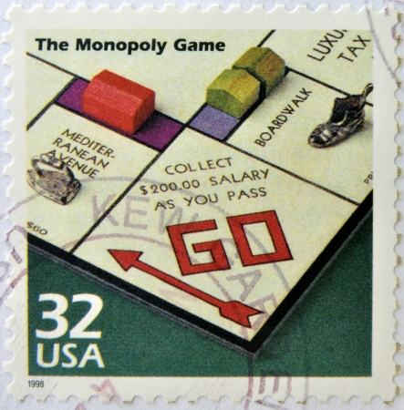 UNITED STATES OF AMERICA - CIRCA 1998: a stamp printed in USA showing an image of monopoly game, circa 1998.