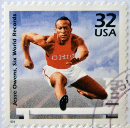 UNITED STATES OF AMERICA - CIRCA 1998: A stamp printed in USA showing an image of Jesse Owens, six world records, circa 1998.