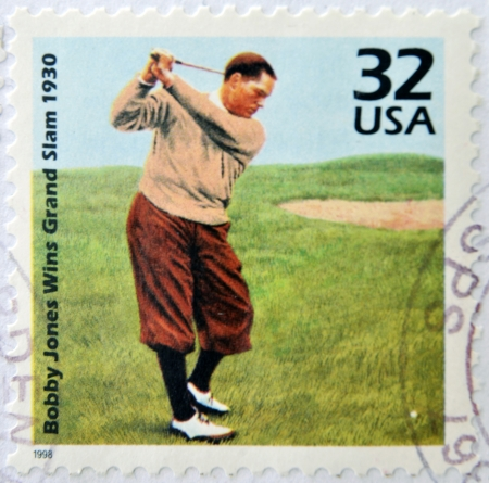 bobby: UNITED STATES OF AMERICA - CIRCA 1998: A stamp printed in USA showing an image of Bobby Jones, wins grand slam 1930, circa 1998.