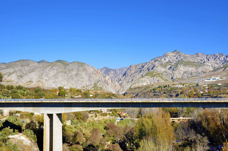 Bridge in Durcal, Granada and background mountains photo