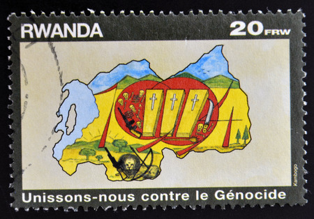 genocide: RWANDA - CIRCA 1990: A stamp printed in Rwanda dedicated to fight against genocide, circa 1990  Editorial