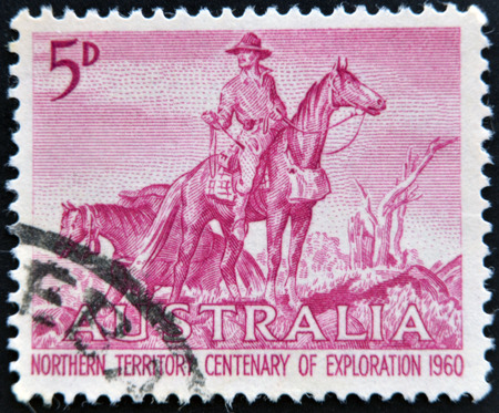 stockman: AUSTRALIA - CIRCA 1960: a stamp printed in Australia shows The Overlanders by Sir Daryl Lindsay, Centenary of Exploration of Australias Northern Territory, circa 1960  Editorial