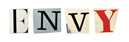 seven deadly sins: Envy formed with magazine letters on a white background