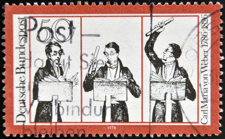 weber: GERMANY - CIRCA 1976: A stamp printed in German Democratic Republic (East Germany) honoring Carl Maria von Weber, shows musicians, circa 1976  Editorial
