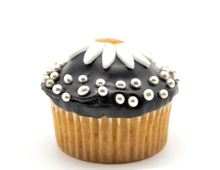 chocolate cupcake with a daisy photo
