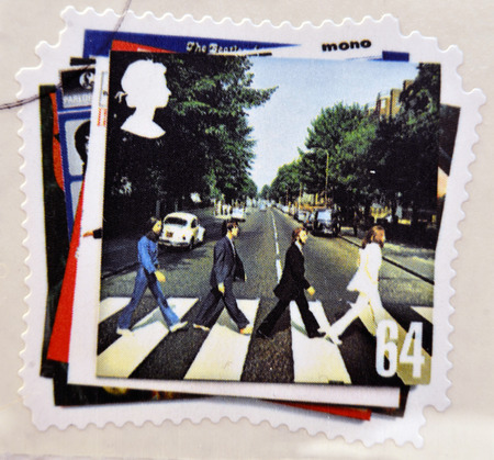 john lennon: UNITED KINGDOM - CIRCA 2007: a postage stamp printed in Great Britain showing an image of The Beatles, Abbey Road album cover, circa 2007.  Editorial