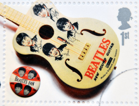 john lennon: UNITED KINGDOM - CIRCA 2007: A stamp printed in Great Britain shows the Beatles memorabilia (guitar and pin), circa 2007.