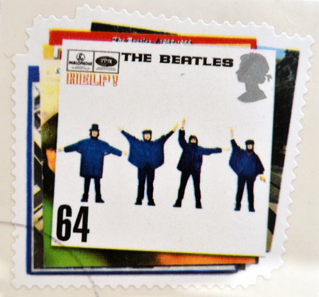 the beatles: UNITED KINGDOM - CIRCA 2007: a postage stamp printed in Great Britain showing an image of The Beatles, Help album cover, circa 2007.